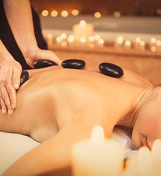 Professional beautician massaging female