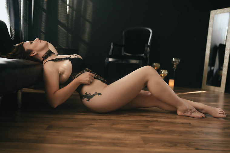 Tampa Luxury Boudoir Photograph Beautiful Woman Laying On Black Couch