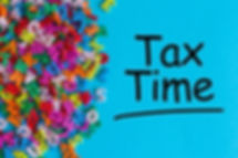 Tax time - message on an office desk wit