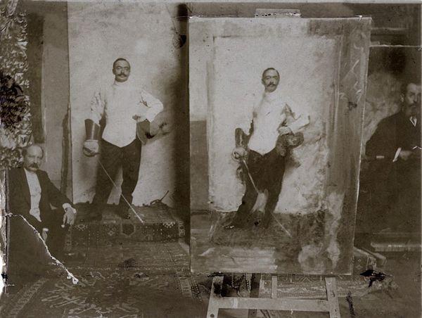 Cesare Tallone in his studio in Corso Garibaldi, with Alessandro Pirovano posing next to his portrait, 1911