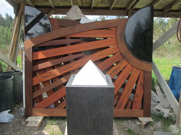 A white onyx stone pyramid on a pedestal.