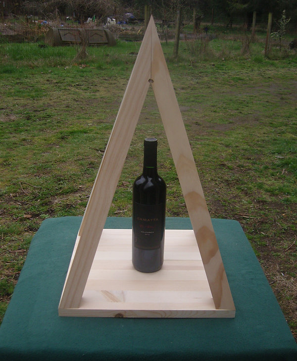 The Nubian Tabletop Pyramid with a bottle of wine inside.