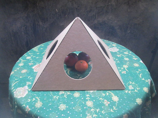 The Open Giza Fold-up Cardboard Pyramd with fruit inside.