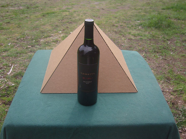 The Giza Fold-up Cardboard Pyramd with a bottle of wine for comparison.