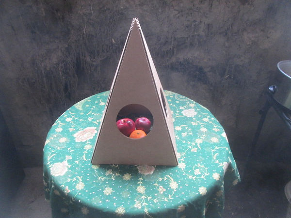The Open Nubian Fold-up Cardboard Pyramid with fruit inside.