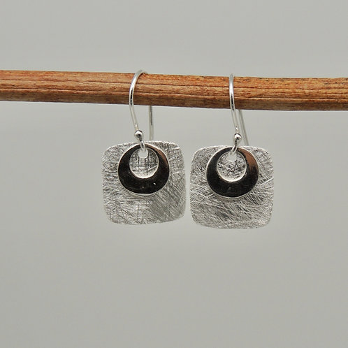 Brushed silver square earrings.
