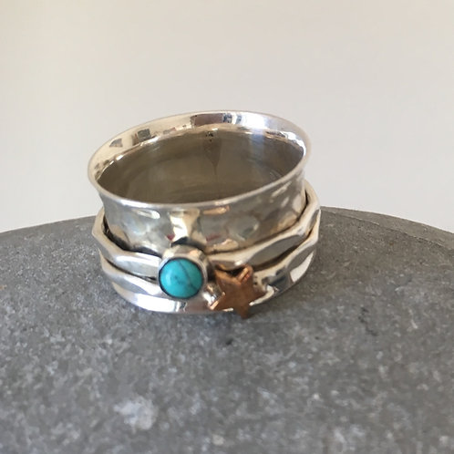 Beaten silver spinning ring with  turquoise  stone
