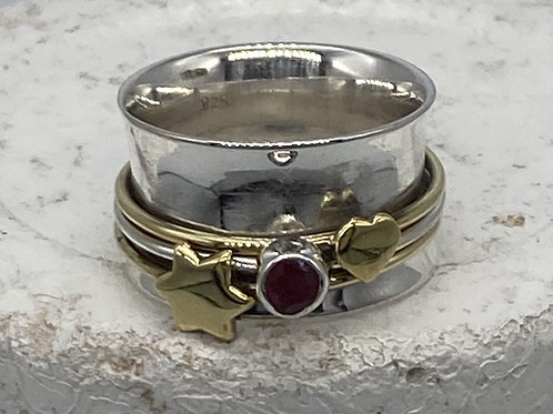 Silver and Brass Spinning Ring, with a cut ruby stone, heart and star motif