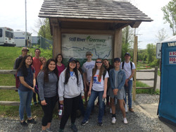 DHS students pose in front of the Brookfield Greenway map at the trailhead at the end of the day