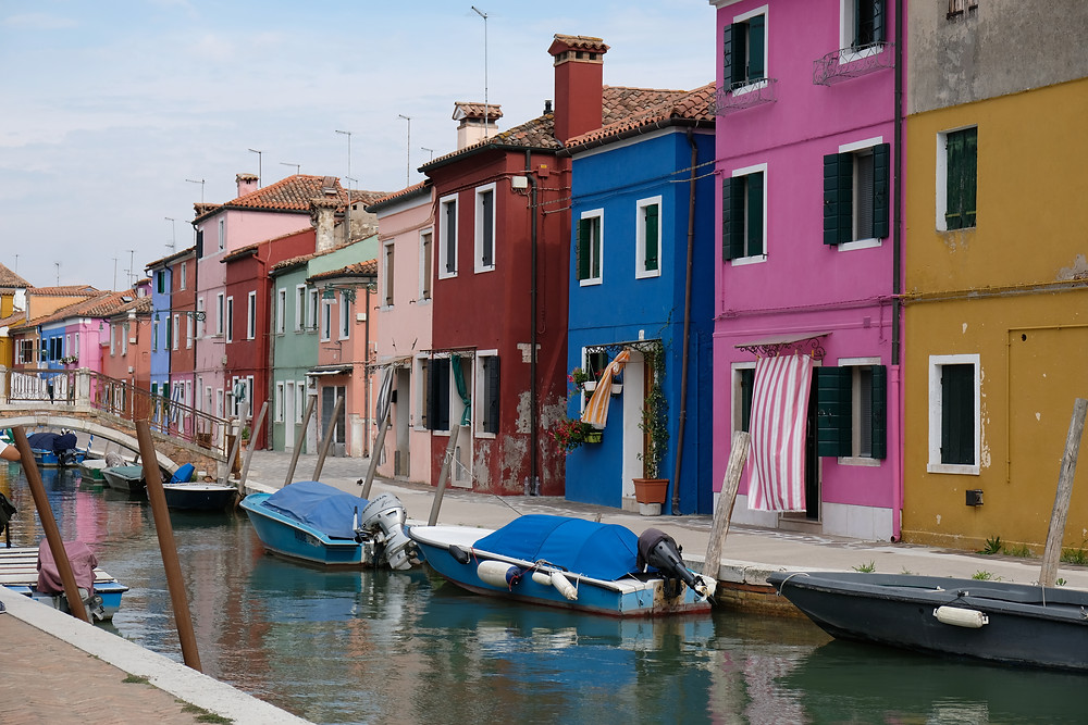 multi colored houses along the water in Burano Italy