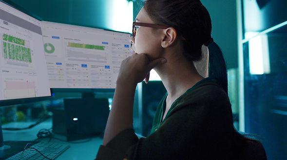 Woman Looking at Screens.jpg