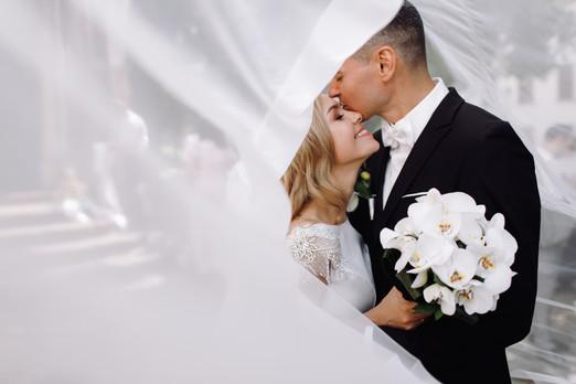 groom-black-tuxedo-hugs-tender-stunning-