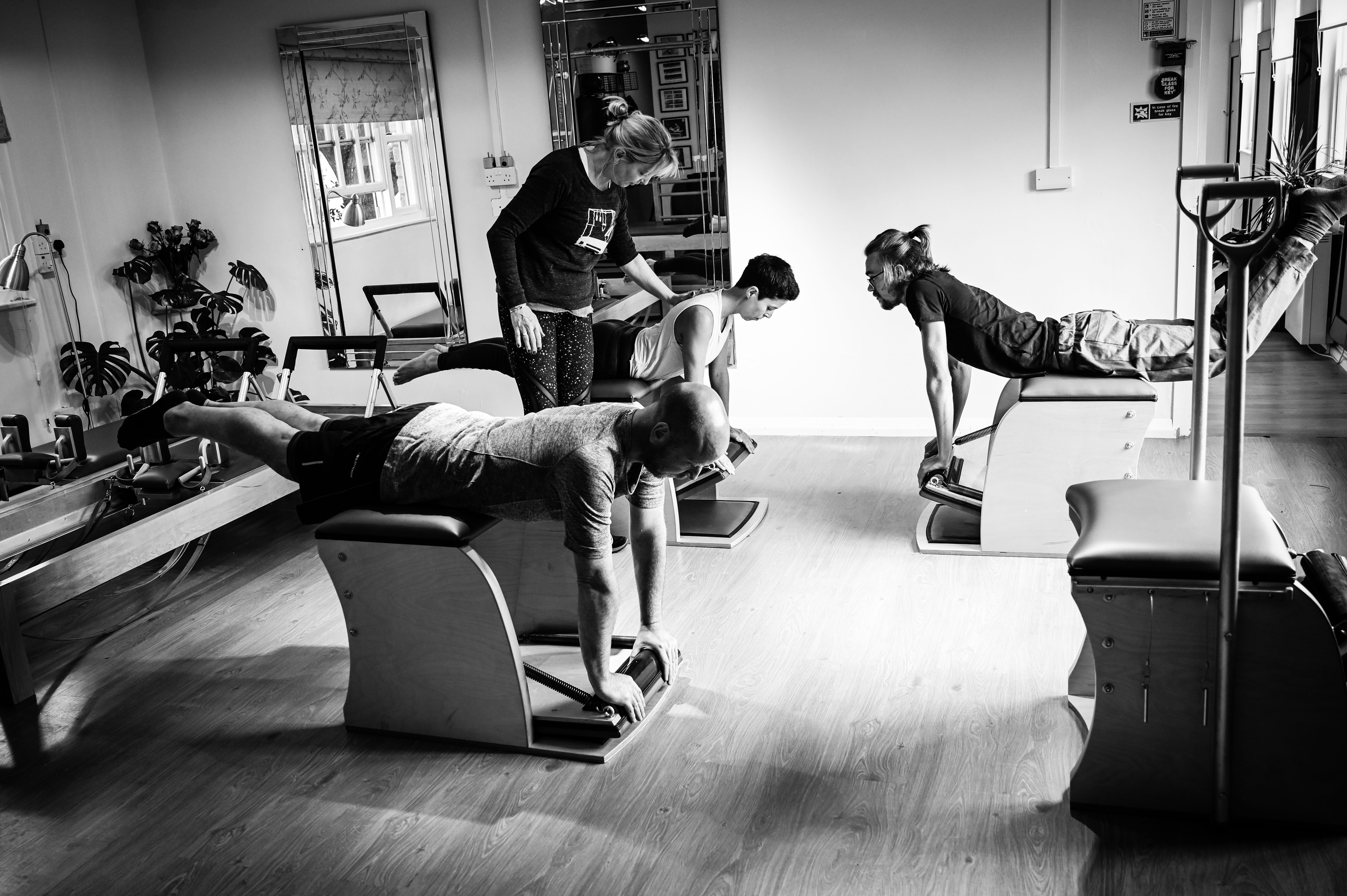 pilates clients on Wunda Chair exercise at Studiq