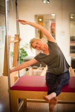 Lizzie Qualie stretching in Cirencester pilates studio