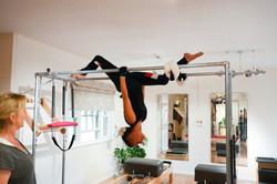 women on pilates equipment