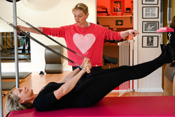 Lizzie Quaile with client on pilates equipment