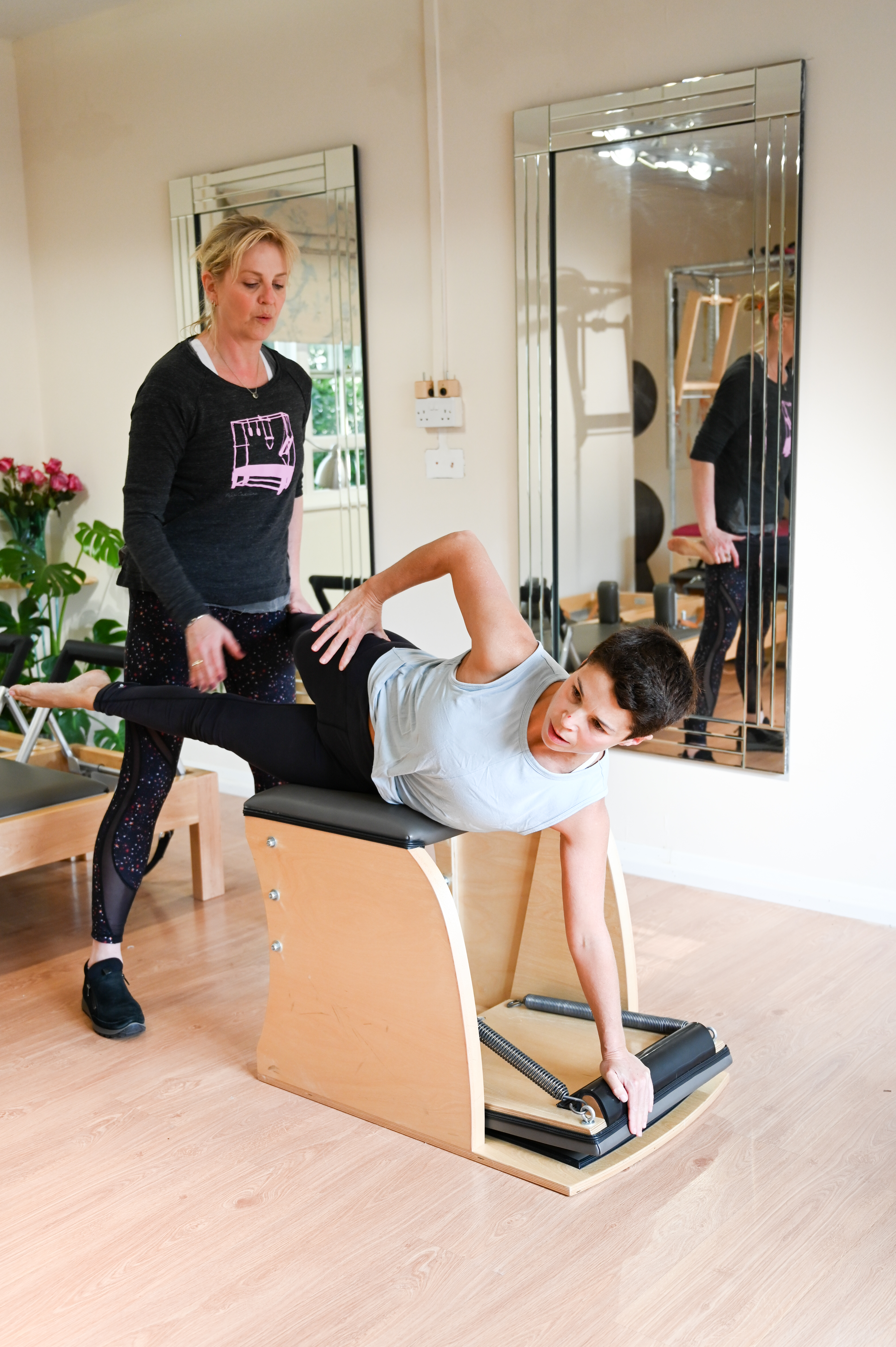 Lizzie Qualie helping client with a stretch