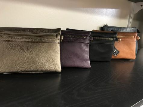 We have a wide array of Joy Susan wallets, crossbody purses, handbags and backpacks!