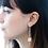 Thumbnail: Gienah Long Linear Single Bloom Dangle Moissanite Earring