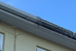 dirty gutter wehalfway through our gutter cleaning service in ottery st mary, Eastdevon
