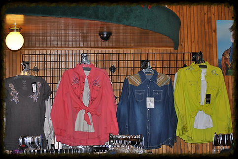 WOMAN'S WESTERN SNAP OR BUTTON UP BLOUSES