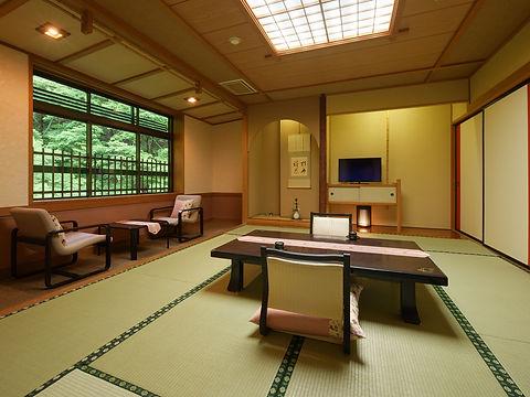 源泉かけ流し風呂付客室.jpg