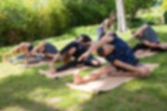 Group-Of-People-Practicing-Yoga.jpg