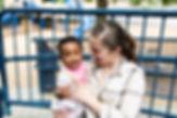 teacher holding infant