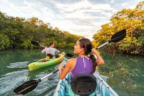 Couple kayaking together in mangrove riv