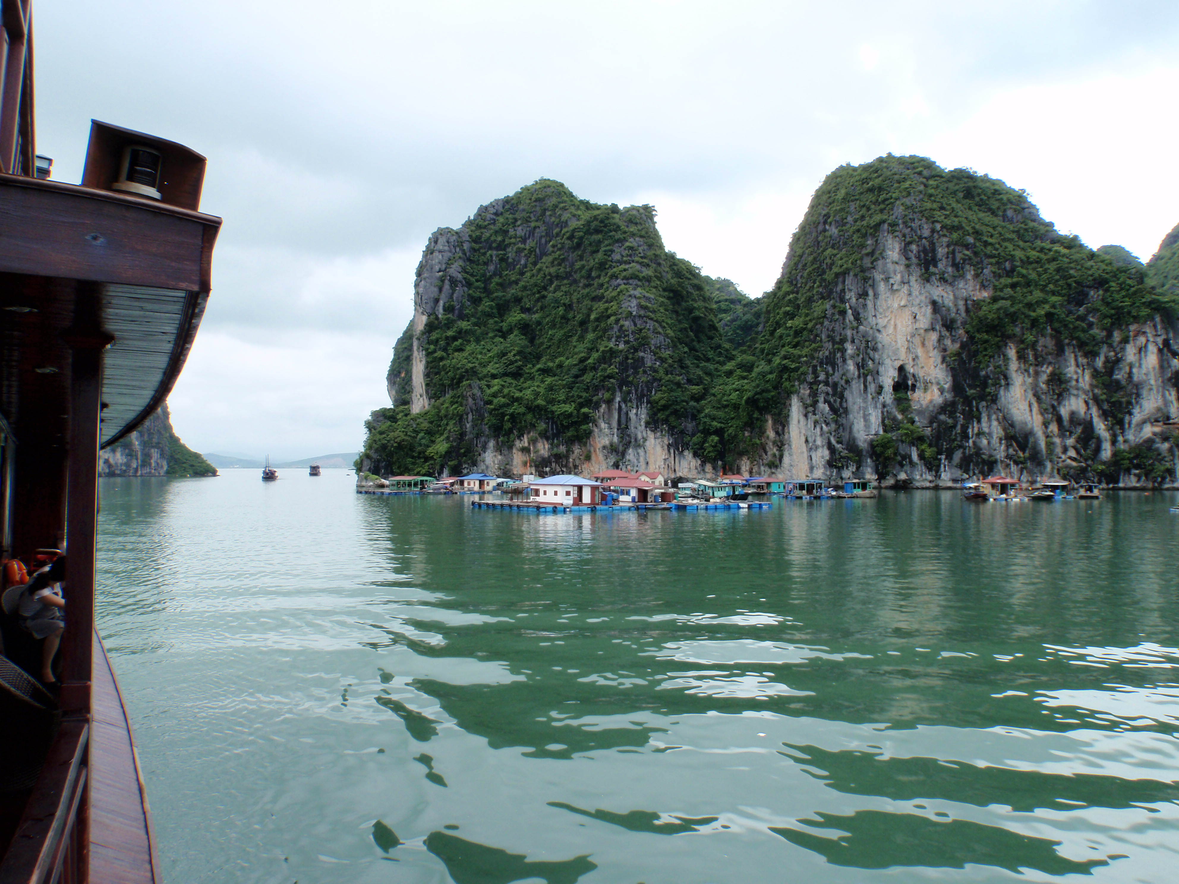 Setting off past floating village