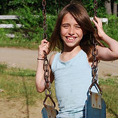 Girl Smiling on Swing_edited.jpg