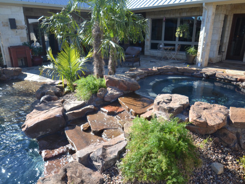 Raised spa with Natural Streambed