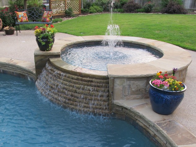 Circular spa with stair stepped spillway