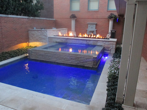 Perimeter overflow spa with fire