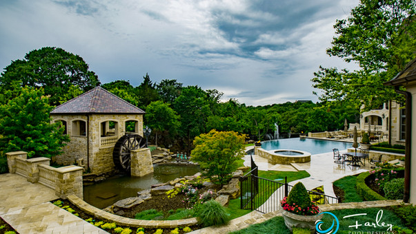 Flower Mound Infinity Pool Project with Water Wheel