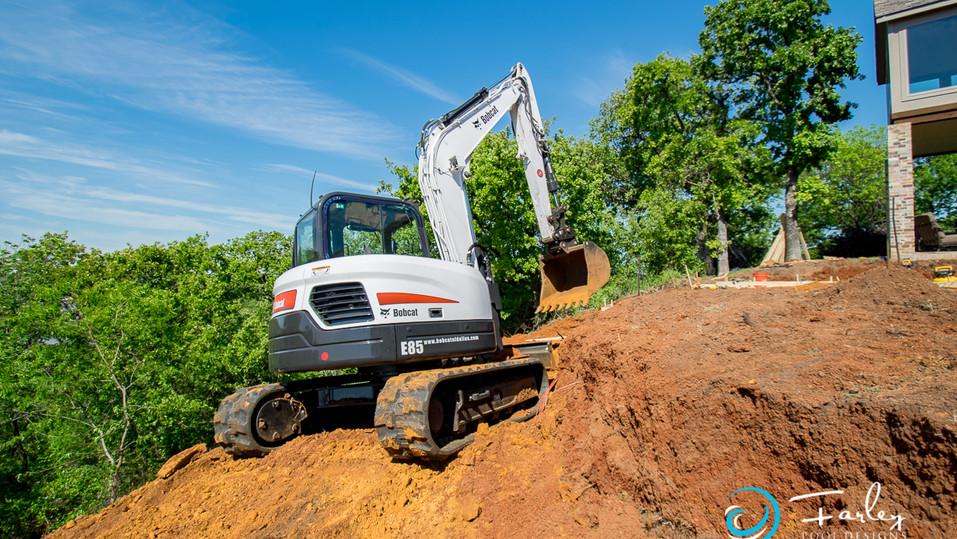Digging hillside pools