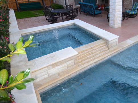 Spa with stair stepped spillway