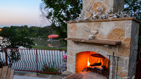 Fireplace next to Pool