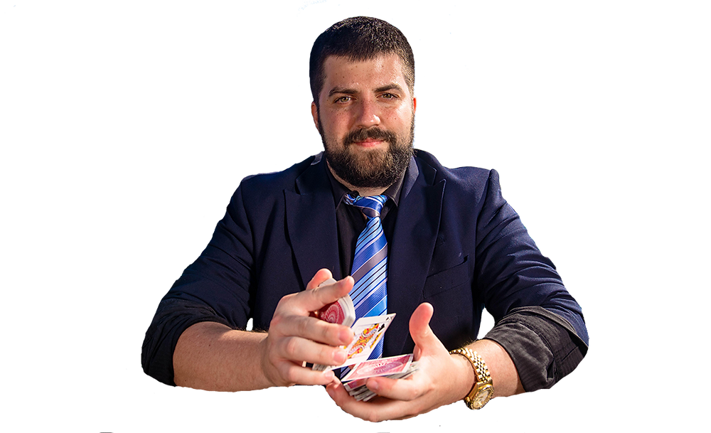 magician & illusionist daniel chard posing for the camera while shuffling a deck of playing cards