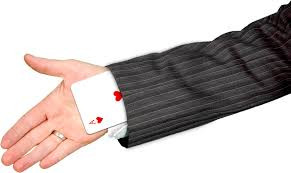 card trick being performed by a magician using sleeve and hand
