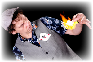 magician performing card fire trick in front of the camera