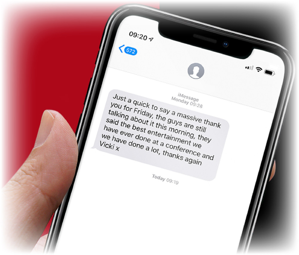 a text message on an iPhone X from a happy customer complementing a magicians entertainment skills at a recent event