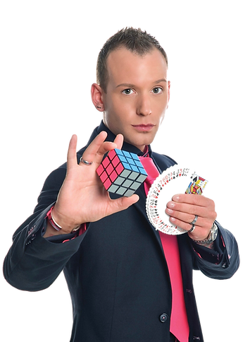 Steve Dela, a Slightly Unusual magic entertainer poses with a rubik's cube and playing cards.