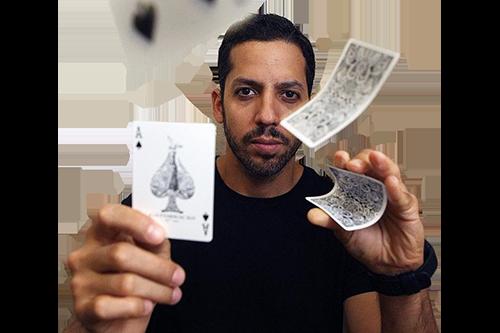 David Blaine flicking cards at the camera