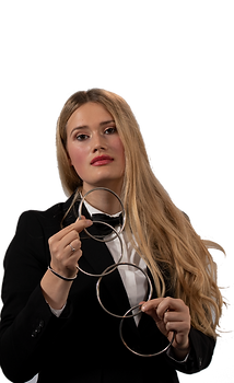 a slightly unusual female illusionist poses with magic ring props