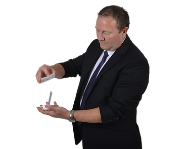 Paul Hancox, a Slightly Unusual illusionist and entertainer shuffles a deck of playing cards.