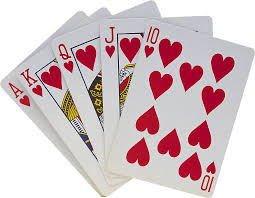 a stack of playing cards displaying hearts of Kings, Queens, Jacks, Aces and a ten