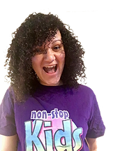 Female childrens entertainer with curly hair