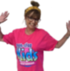 female Kids entertainer with arms in air wearing a pink non stop kids entertainment top
