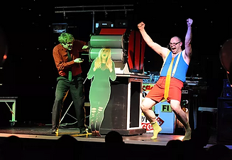 magician assistant is flattened in a magic trick on stage while other magician celebrates for crowd